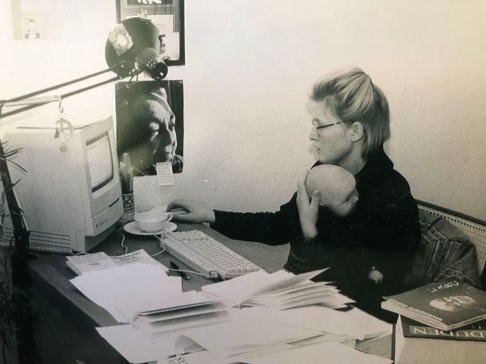 My Mom Holding Myself Whilst Writing Her Master Thesis On The Macintosh Classic II (1991)